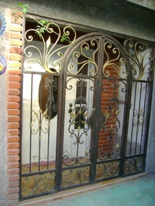 Ornate metal security doors google search home safety for Puertas hierro forjado